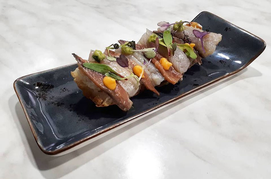 Dúo de arenque marinado y anchoa del Cantabrico